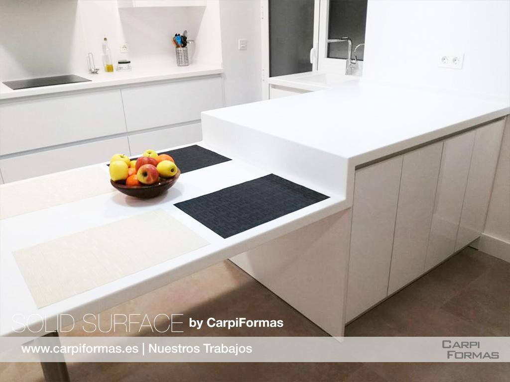 Isla cocina blanca Solid Surface.